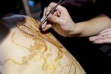 The finish of the body art on the model