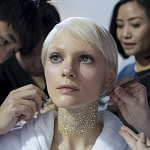 Model during the application of the glitters one by one