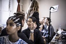 Model Chiharu Okunugi during making up before Ulyana Sergeenko's runway show for Haute-Couture. Le mannequin Aiden Curtiss au maquillage avant le défilé Haute-Couture de la créatrice Ulyana Sergeenko.