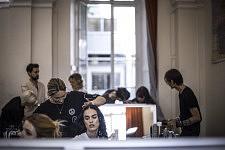 Model having her hair done before the Haute-Couture runway show of Ulyana Sergeenko. Mannequin se faisant coiffer avant le défilé Haute-Couture de Ulyana Sergeenko.