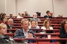 Woman laughing in the Public, the ICCEC 2014, Ecole de Médecine, Paris.Femme riant dans le public de l'ICCEC 2014, Ecole de médecine, Paris.