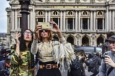 Gilda d'Ambrosio and Candela Novembre taking a selfie in front of Opéra Garnier after the Stella Mc Cartney runway show during Paris Fashion Week, Paris March 2015. Gilda d'Ambrosio and Candela Novembre faisant un selfie devant l'Opéra Garnier, à la sortie du défilé Stella Mc Cartney pendant la Fashion Week, Paris March 2015.