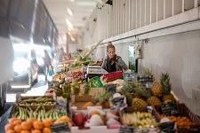 Fruits and vegetables seller at Marché Victor Hugo. Une marchande de fruits et légumes au Marché Victor Hugo.