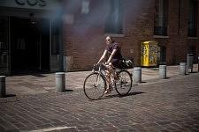 Woman on a bike in the center of Toulouse. Jeune femme à vélo dans le centre ville.