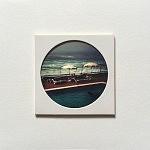 """""""Grand Hôtel"""", pièce unique 10 x 10 cm, signée au dos, faite à la main par la photographe. Image choisie, découpée, recadrée, insérée derrière le hublot protecteur, comme une loupe sur la miniature, fixée au papier canson, avec un espace de méditation neutre autour du cercle de l'image, le tout sur un support carton plume d'un centimètre d'épaisseur. Le motif circulaire est aussi un hommage à l'écrivain poète portugais Fernando Pessoa qui portait des lunettes cerclées."""