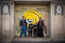 Dorina, her husband  and the kids posing on the building door where they lived for years outside.La famille de Dorina et son mari posant sous la porte cochère où toute la famille a vécu plusieurs années.