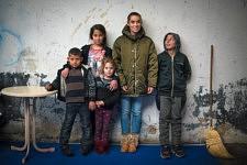Daily life inside a squat of Marseille, former french army quarter. Here the kids are posing with Jane Bouvier. Scène de la vie quotidienne dans un squat de Marseille, ancienne carserne de L'armée française. Ici, les enfants posent avec Jane Bouvier.