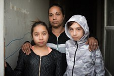 The twins back from school with their mum in a squat of Marseille, former french army quarter. Les jumeaux de retour de l'école avec leur maman dans un squat de Marseille, ancienne carserne de L'armée française.