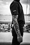 Tattooed arm of a private security guard on the Croisette, Cannes, May 2017. Bras tatoué d'un agent de sécurité sur la Croisette, Cannes, Mai 2017.