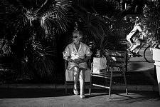 Old lady watching the street life on the Croisette, Cannes Film Festival 2017. Une dame âgée observant le spectable de la rue sur la Croisette, Festival de Cannes 2017.