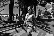 Young woman strolling on the Croisette; Cannes Film Festival 2017. Jeune femme marchant sur la Croisette, Festival de Cannes 2017.