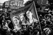 "Flag ""Justice and Truth"" for the three Kurdish activists, Sakine Cansiz, Fidan Dogan (Rojbîn) et Leyla Saylemez killed in France in 2013 floatting above the crowd in Toulouse. Le Drapeau Justice et Vérité pour les 3 militantes Kurdes Sakine Cansiz, Fidan Dogan (Rojbîn) et Leyla Saylemez assassinées en France en 2013."