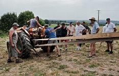 Men trying to fix a problem on the old tractor, Saint-Martin Cantalès, 2012. Les hommes essayant de comprendre une panne sur le vieux tracteur, Saint-Martin Cantalès, 2012.