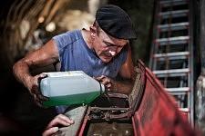 Repair operation inside the barn to get the old tractor back to life, Saint-Martin Cantalès, 2012. Réparation à l'intérieur de la grange pour remettre en marche le vieux tracteur, Saint-Martin Cantalès, 2012.