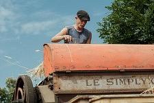 Marc Chambon on top of the vintage combine harvester dealing with the corn, Saint-Martin Cantalès, 2012. Marc Chambon au sommet de l'ancienne batteuse s'occupant du blé qui monte, Saint-Martin Cantalès, 2012.