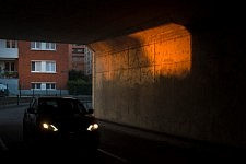 Car passing in a tunnel under a red sunny ray of light, Toulouse; december 2016. Voiture passant dans un tunnel sous un rayon solaire orangé, Toulouse, décembre 2016.