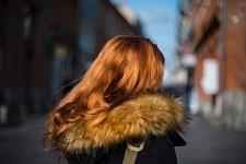 Red hair of a young girl enlighted by the sun in a street of Toulouse, near Place du Capitole, February 2017. Chevelure rousse d'une jeune fille illuminée par le soleil près de la Place du Capitole à Toulouse, Février 2017.