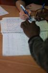 Learning french to foreign minor kids at the day care center of the association Hors La Rue, Montreuil. Apprentissage du français aux mineurs étrangers, au centre d'accueil de jour de l'association Hors La Rue.